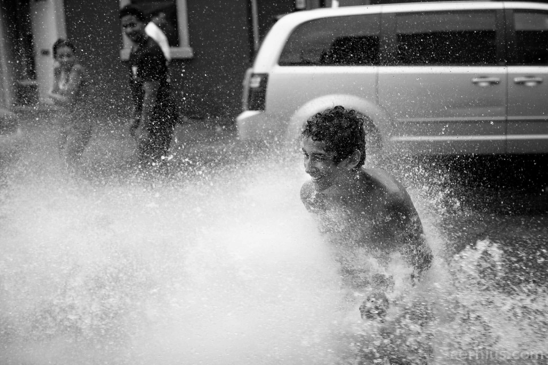 Kids playing in a fire hydrant in Bushwick, Brooklyn | Juozas Cernius
